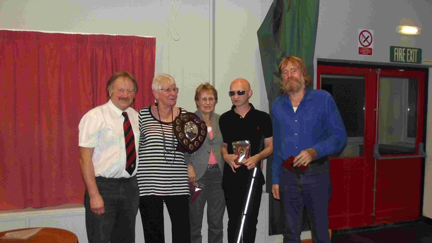 KNOWLEDGE: Bridport Football Club's chairman Adrian Scadding with the winning team (from left) Pauline Brooks, Jill Beak, Nick Bennyworth and Tony Day.