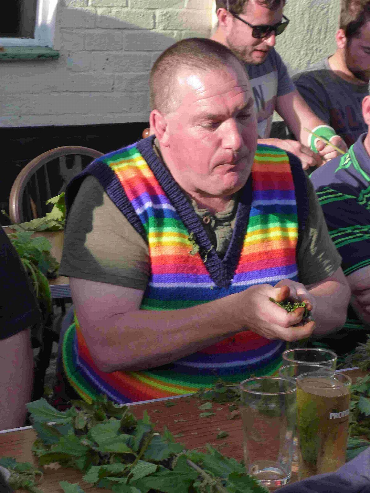 LOTTA BOTTLE: Phil Thorne chomps his way to victory at the nettle eating contest