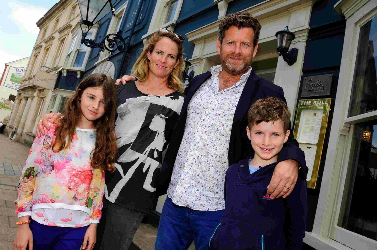 BULL'S EYE: Nikki and Richard Cooper, with their children Teddie and Stanley, outside the hotel which they have owned for eight years
