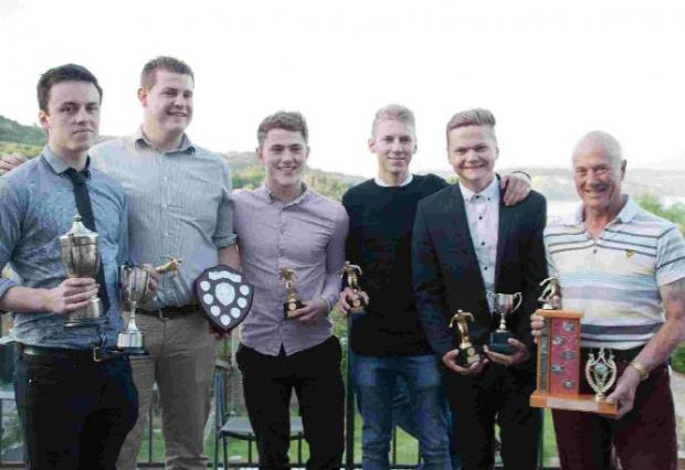 TROPHY TIME: Uplyme FC's award winners show off their prizes at the club's end-of-season presentation night