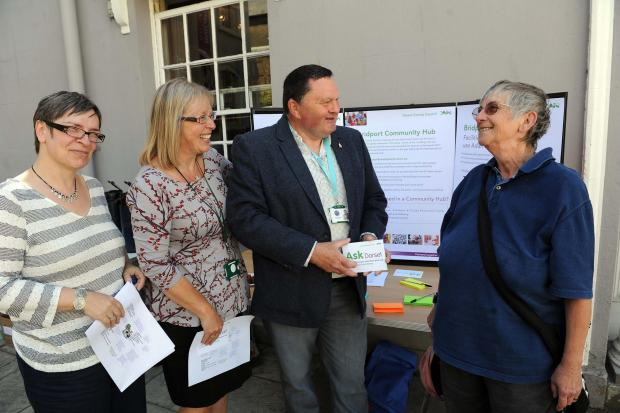 Bridport community-hub public consultation: Diana Balsom, Donna Robson and Daryl Turner chat to local Sal Robinson. Picture Finnbarr Webster