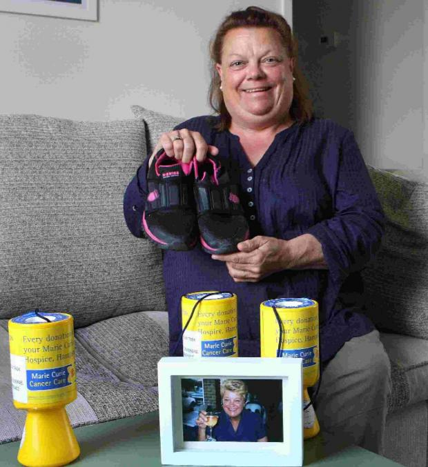 Bridport and Lyme Regis News: PUTTING BEST FOOT FORWARD: Janet Barratt-Pearce with her training shoes and a photo of her mother