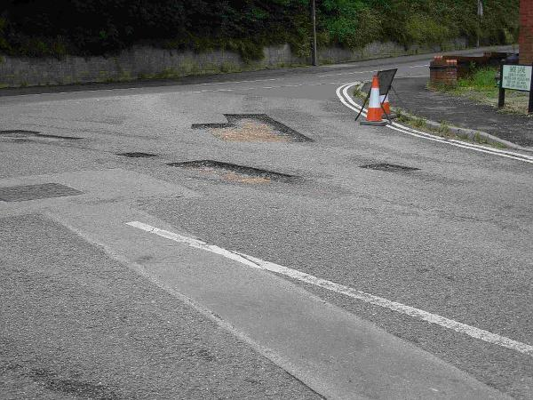 Potholes being mended in Shoe Lane