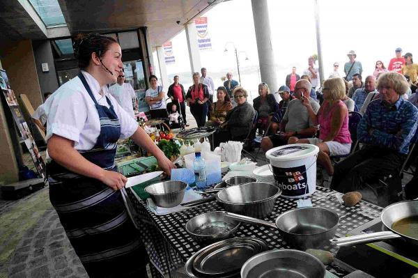 Bridport and Lyme Regis News: COOK-OFF: Chef Lin Pidsley shows off her skills to the crowd.