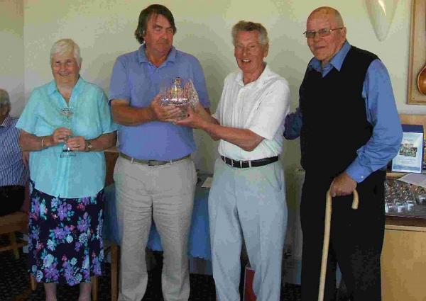 GOLDEN OLDIES: Trevor Foster receives the Golden Oldies Bowl from captain Phil Dowell. Also pictured is Madeline Skelly, left, and Ray Lowe, right