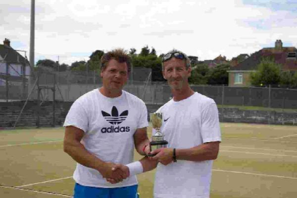 Bridport and Lyme Regis News: MEN'S PRIZE: Singles winner Ian Broughton with club coach Kevin Davis