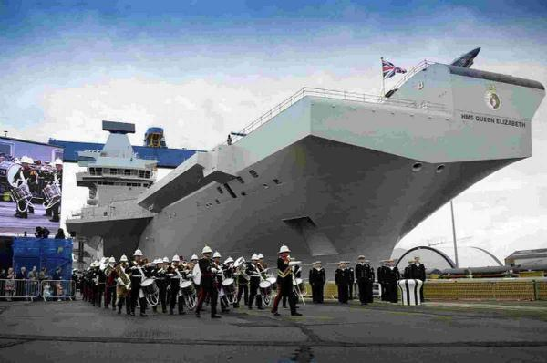 SHOWING THE ROPES: Simon Petitt, the senior naval officer for the Royal Navy's new aircraft carrier ship HMS Queen Elizabeth, main picture