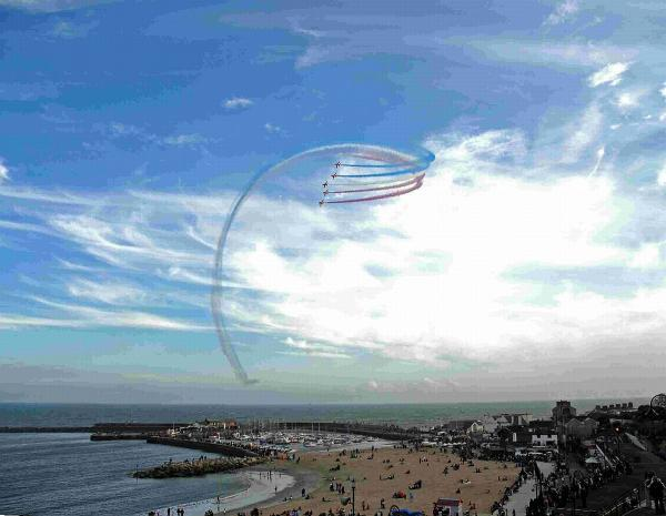Bridport and Lyme Regis News: HIGHLIGHT: The Red Arrows soar across the Lyme Regis skyline