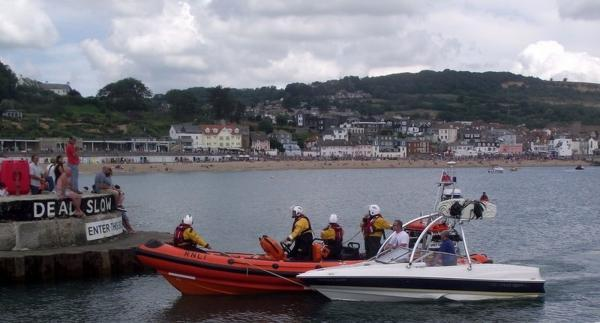 Picture shows the RNLI lifeboat towing the vessel to safety. Pic Richard Horobin