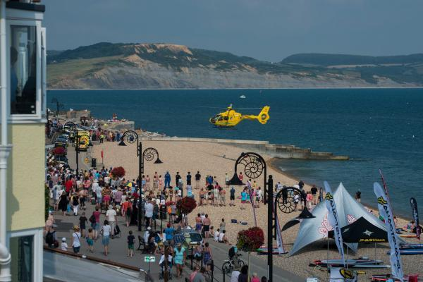 Tributes paid to man who died after collapsing on Lyme Regis beach