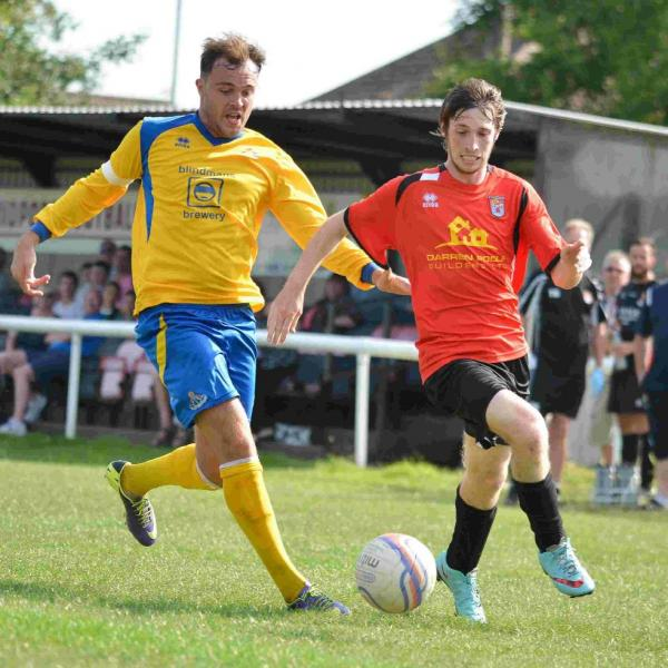 POSITIVE: Matt Morley, right, takes on a Frome defender