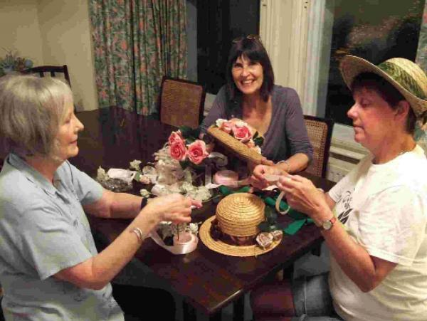 GATHERING: Muriel Finucane, Sheila Meaney and Tracey Dunford-Violet finish the hats