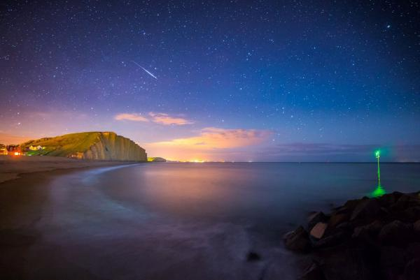 Popular Bridport photographer Stephen Banks took this shot of a meteor streaking through the sky, adjacent to East Cliff, West Bay last year