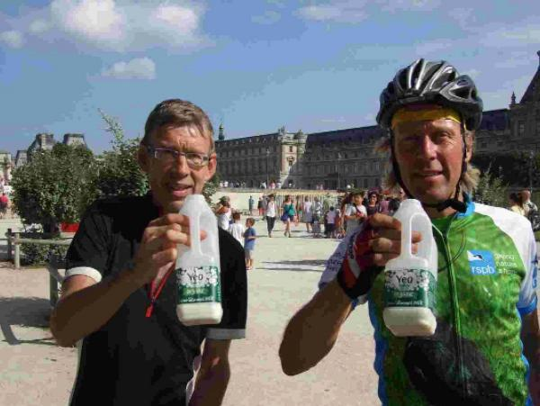 MILK FOR LIFE: Peter Bate and Peter Lemmey celebrating completing the ride in the centre of Paris