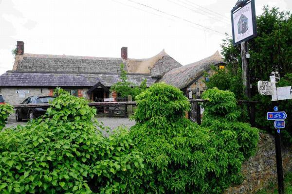 ON THE MARKET: The 700-year-old Shave Cross Inn has a price tag of £495,000. Inset, MP Oliver Letwin