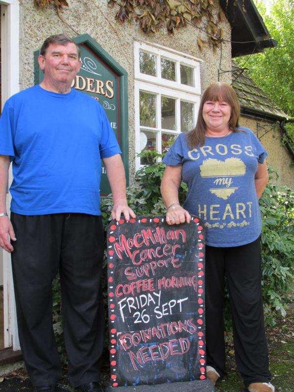 Carolyn (right) and her husband Kevin outside the Loders Arms pub.