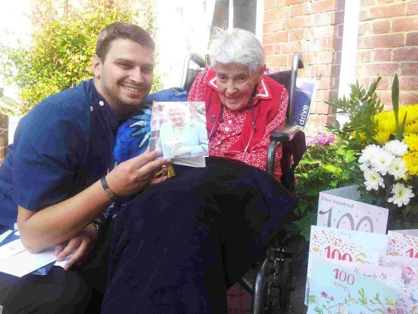 Dorothy with the card from The Queen, with care home nurse manager Stefan Zhelyazkov
