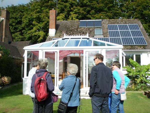 IMPRESSED: Visitors inspect a home with solar panels