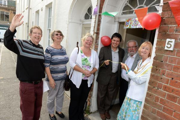 From left, Roz Copson, Lesley Archibald, Ros Kayes, Dr. Andy Mayers, Martin Ray, Bridport Mayor Maggie Ray.