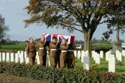 FITTING TRIBUTE: Soldiers of 4 Yorks carry the body of an unknown soldier to his final resting place at  Y Farm military  cemetery