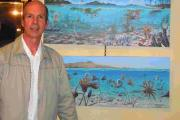 WORKS OF ART: Richard Bizley with his paintings at the book launch