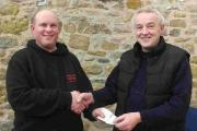 FAYRE SHOW: West Bay SAC Christmas Fayre winner Adam Cullingford, left, is presented with his prize by shore secretary Steve Fowles