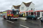 Firefighters called to car on fire outside West Bay Spar. Picture credit: Laing Burgess