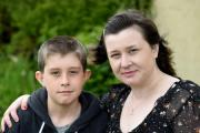 STOLEN BIKE: Young carer Michael Bodycombe and his mum Kelly PICTURE: FINNBARR WEBSTER/F17374