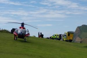 Paraglider air-lifted to hospital after crashing in west Dorset