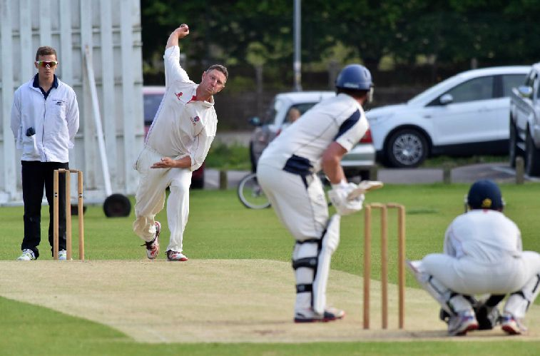 EARLY BREAKTHROUGH: Beaminster bowler Ross Baker