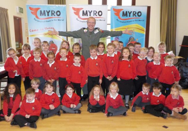 WRITING HELP: Author Nick Rose and pupils at Burton Bradstock Primary School