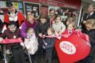 Youngsters from St Mary's School in Axminster help open the new-look Post Office branch (55038182)