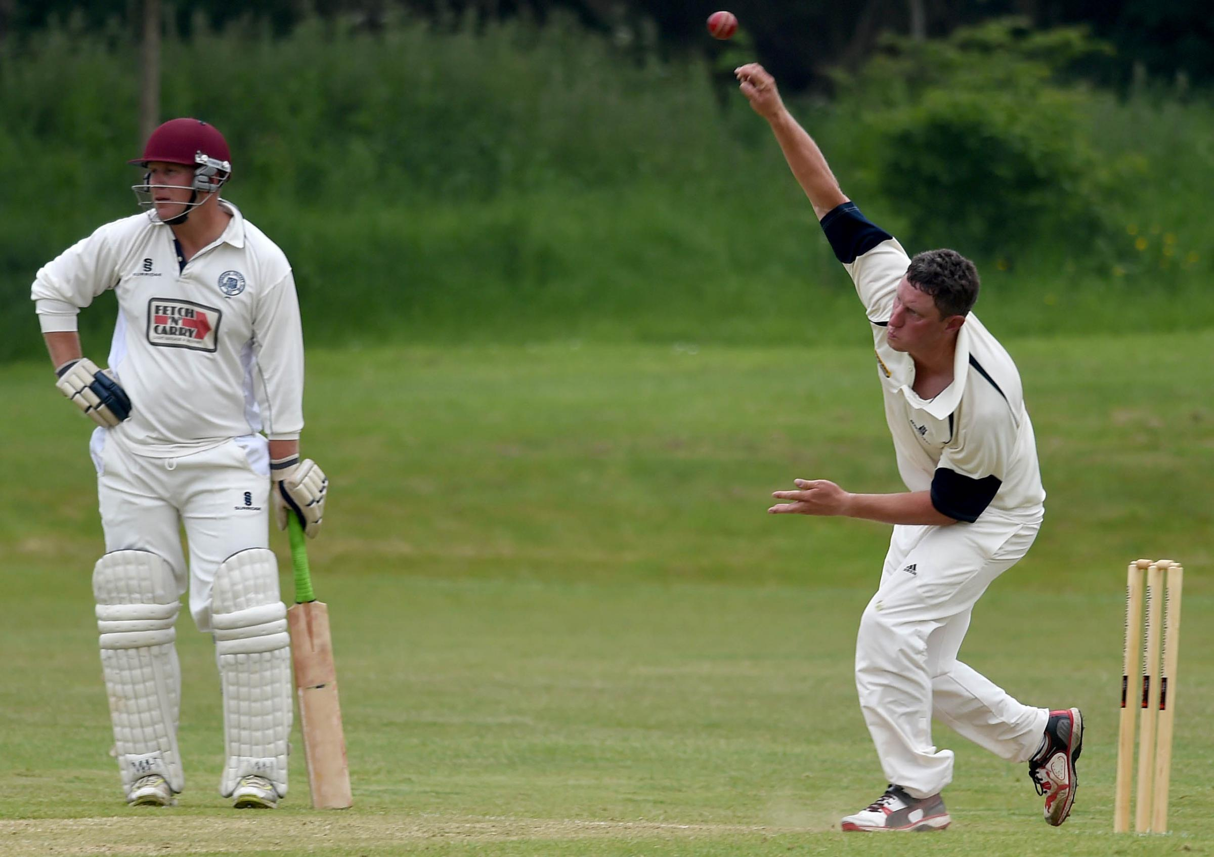 VALIANT EFFORT: Ross Baker bowled economically in Beaminster's loss	    Picture: FINNBARR WEBSTER/F18204