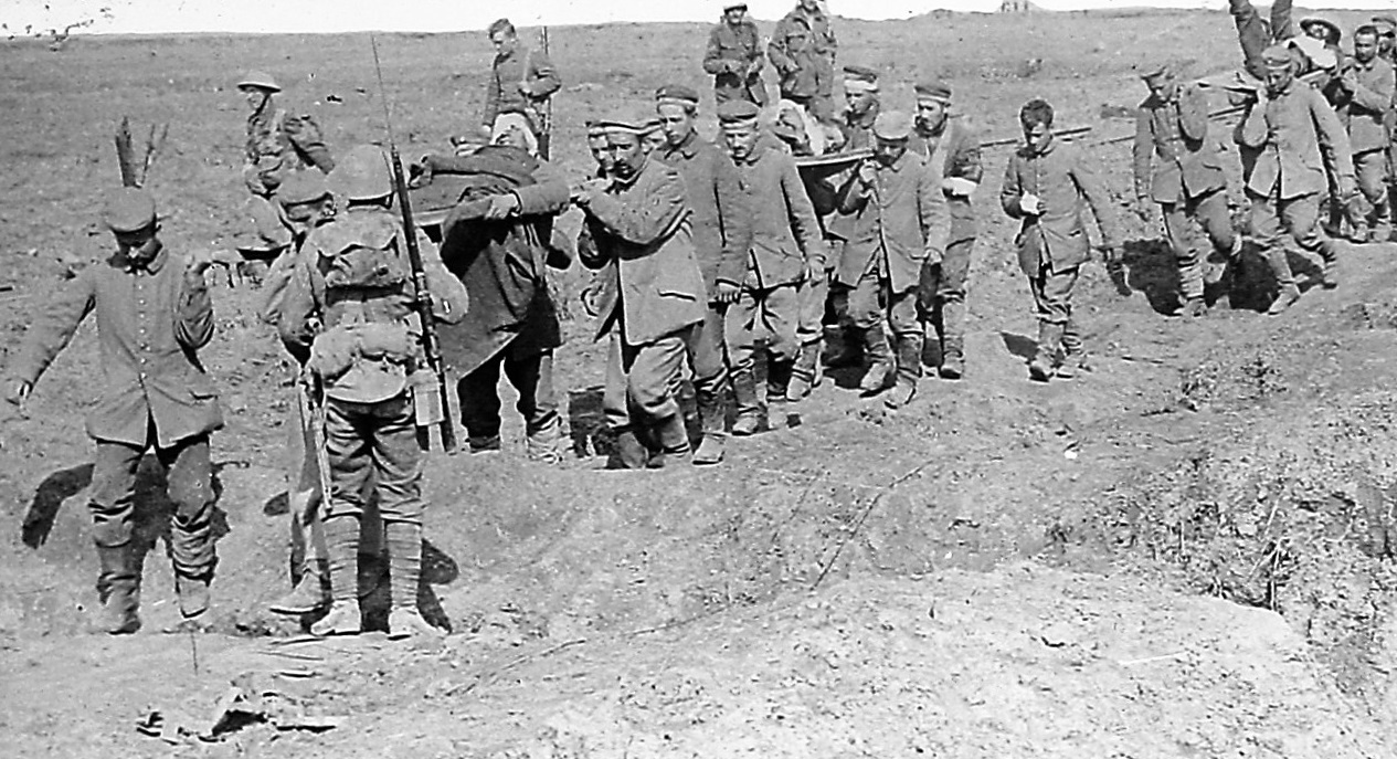 WOUNDED: German prisoners help to carry British wounded back from the front line