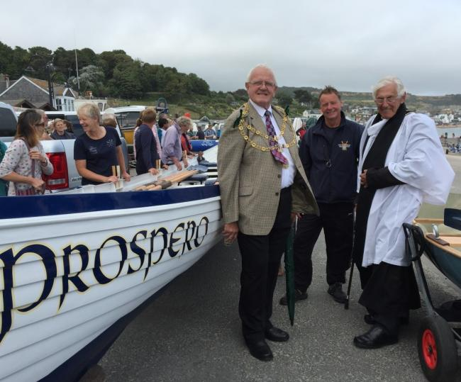 BLESSING: From left: The mayor of Lyme Regis, Owen Lovell, with Marcus Dixon, chairman of Lyme Regis Gig Club, and Reverend Keith Vivian at the launch of the club's new Cornish Sea Skiff, Storm Force, and pilot gig, Prospero