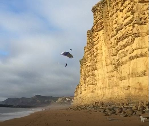 SHOCK: The dramatic moment a BASE jumper launched from the cliffs at East Cliff Picture: CAROLINE WALTERS