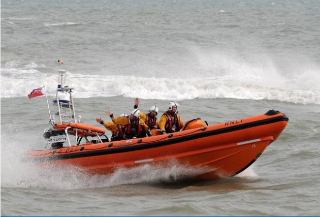 Coastguards rush to help 'three people cut off by tide'