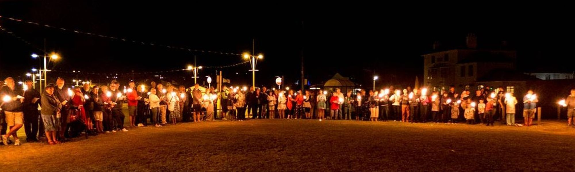 COMMEMORATION: A torchlight vigil at West Bay marked the beginning of the First World War PICTURE: Neil Barnes
