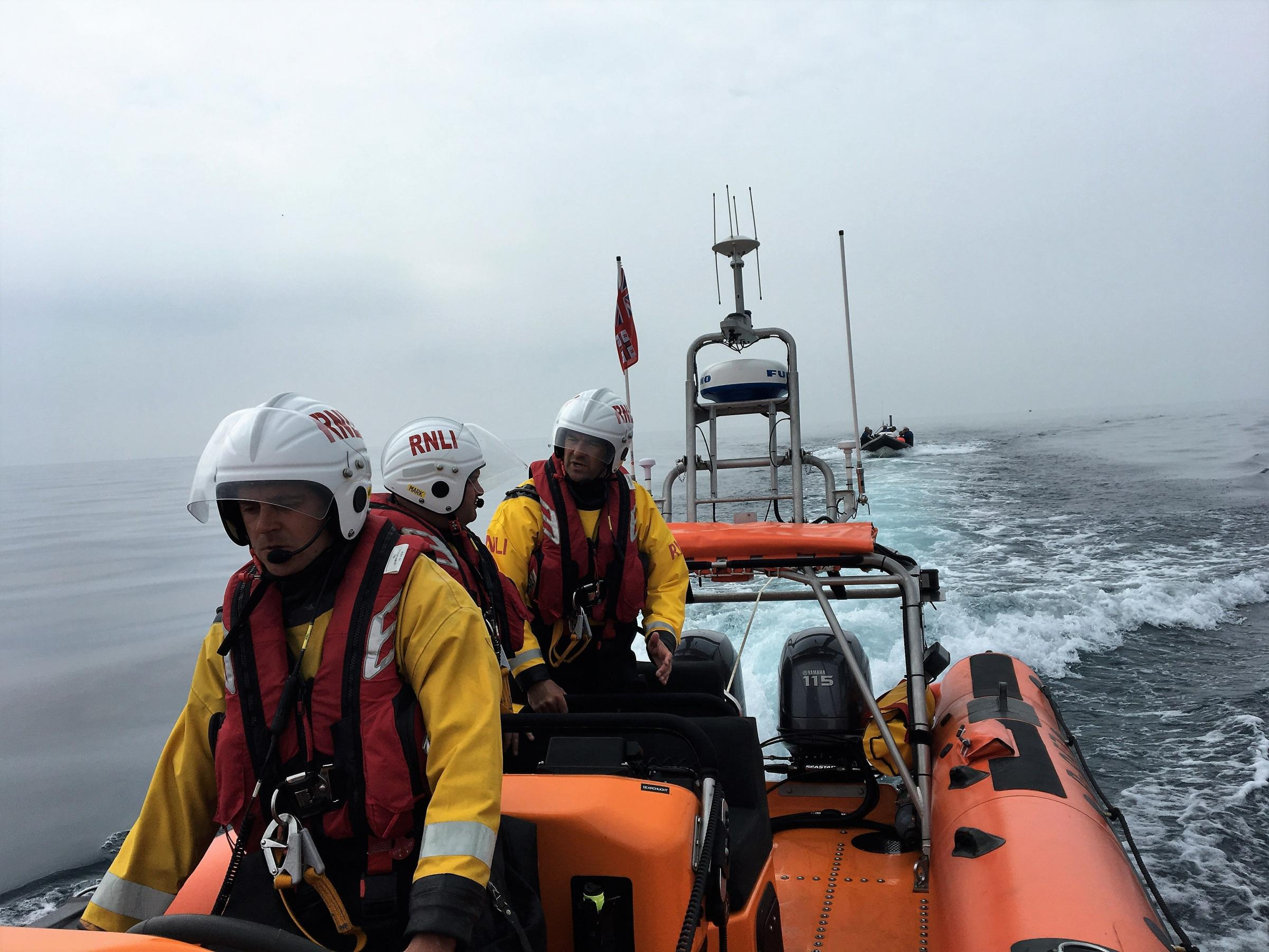 RESCUE EFFORT: Eight divers were helped ashore Picture: LYME REGIS RNLI