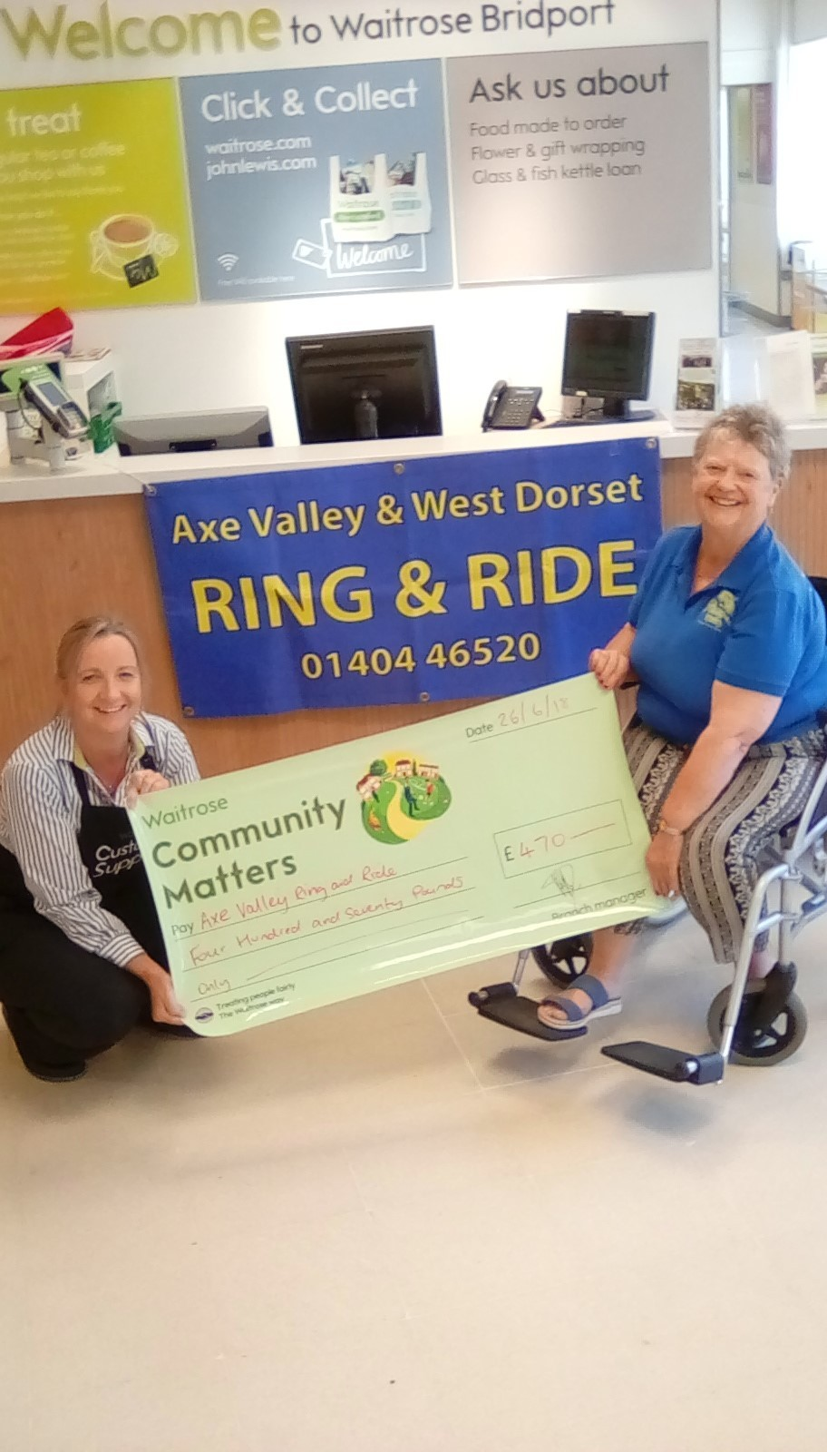 Tara Dobel of Waitrose presenting a cheque to Sandra Ward of Axe Valley and West Dorset Ring and Ride