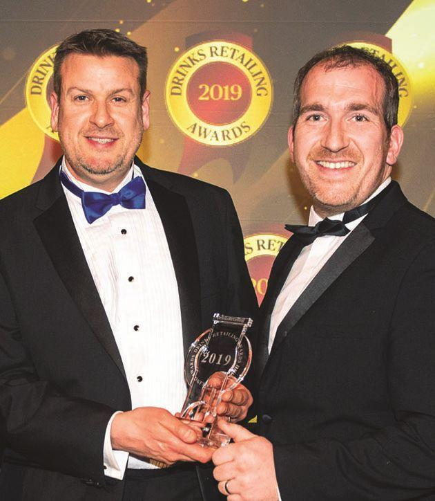 Andrew Dike (left) with fellow director Adam Vincent receiving the award in London