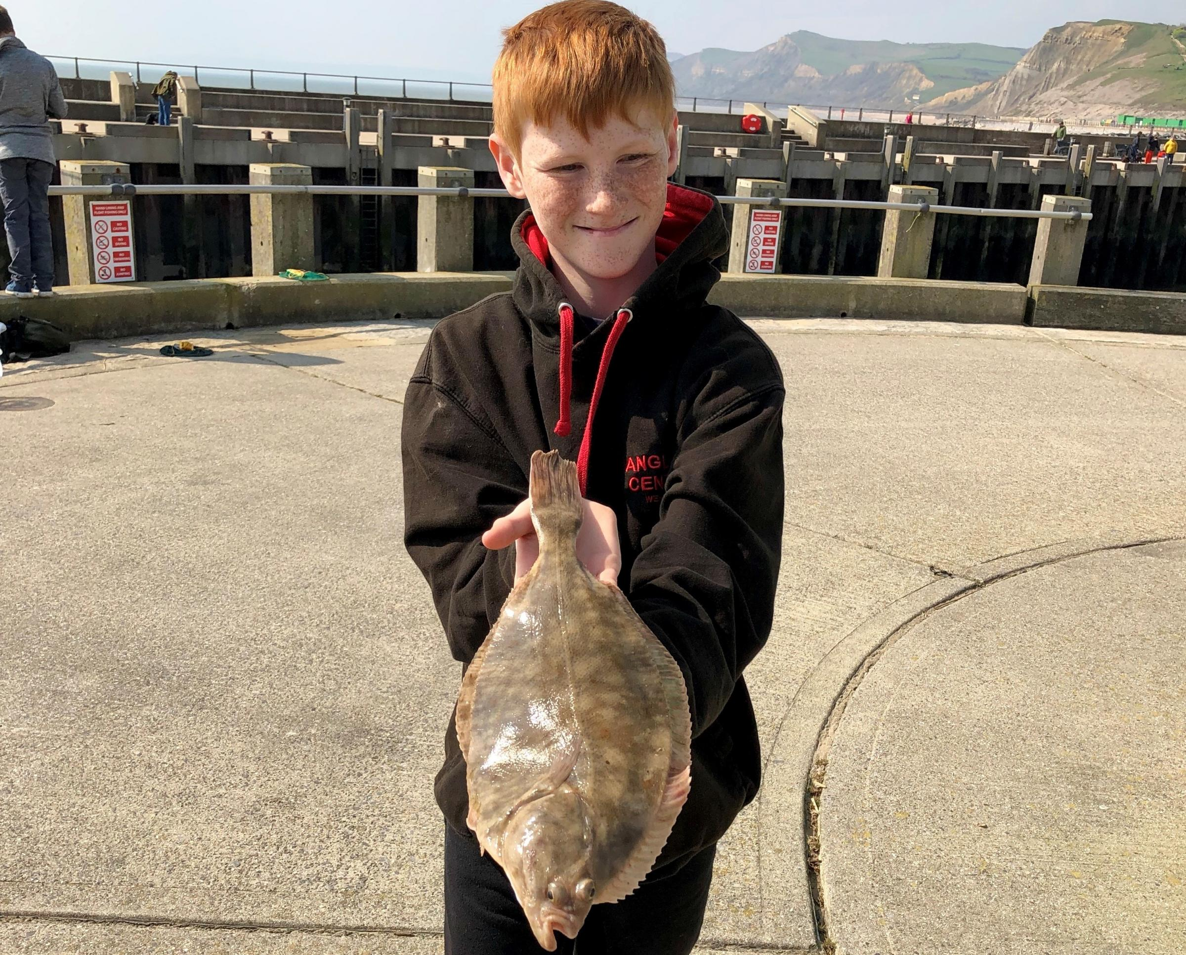 FINE FLOUNDER: Aaron with his winning flounder Picture: MALVIN CHAMBERS