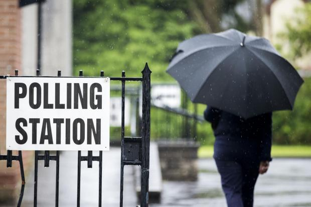 File photo dated 08/06/17 of a voter arriving at a polling station, as figures show that there has been a last-minute rush in applications to register to vote in this year's local elections, ahead of Tuesday's deadline. PRESS ASSOCIATION Photo. Is