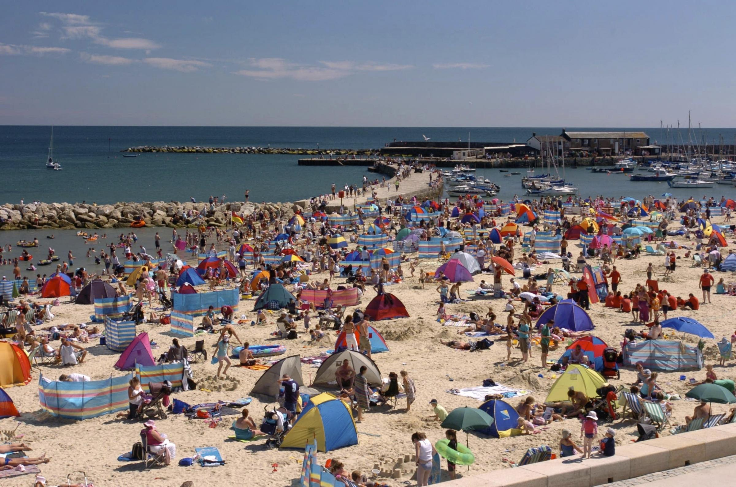 Dorset Magic, Coast Pictures.  Holiday makers pack the beach next to The Cobb, Lyme Regis, Picture: GRAHAM HUNT/HG2728.
