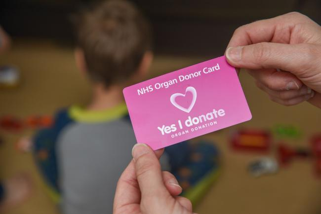 """Yes I donate"" NHS organ donor card. Card in hand.."