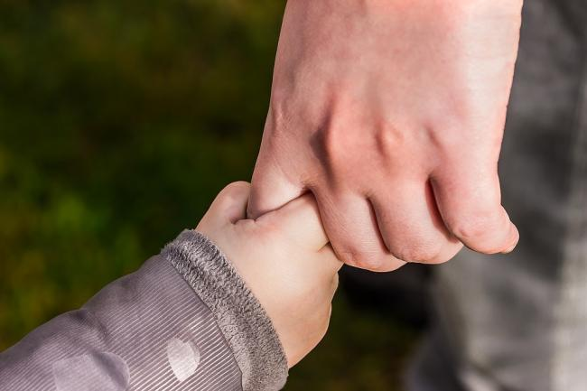 Holding a child's hand. Picture via Pixabay